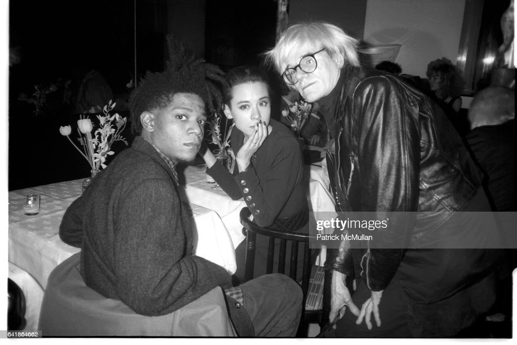 Jean-Michel Basquiat, Tina Chow, and Andy Warhol at Susan Blond's dinner party for Ozzy Osbourne at Mr : News Photo