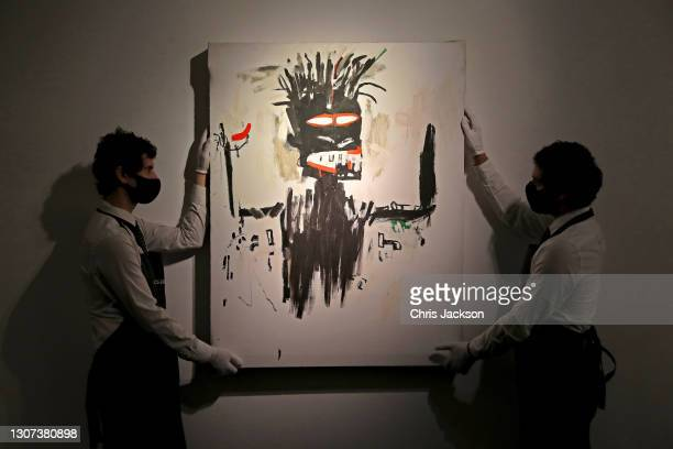 Jean-Michel Basquiat's self portrait during preparations for the livestreamed art sales at Christie's Auction House on March 16, 2021 in London,...