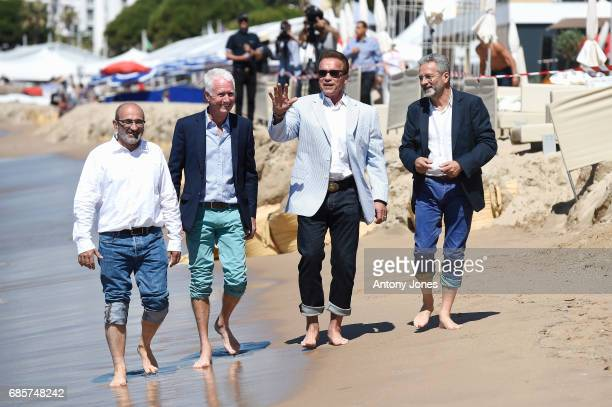 JeanMichel Cousteau guests attend Arnold Schwarzenegger and JeanMichel Cousteau Photocall for 'Wonders of the Sea 3D' during the 70th annual Cannes...