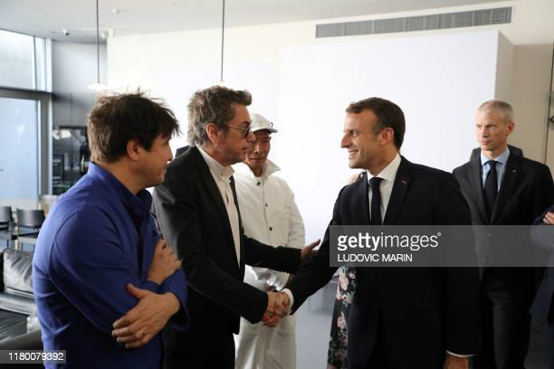 JeanMichel Jarre meets with French President Emmanuel Macron before a lunch at the Pompidou Center in Shanghai on November 5 2019