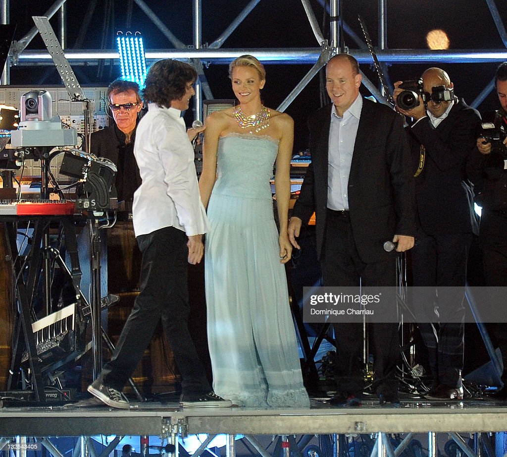 Jean-Michel Jarre, Prince Albert of Monaco and Princess Charlene of Monaco on stage during the Jean Michel Jarre concert celebrating the wedding of Prince Albert II of Monaco to Charlene Wittstock at Port of Monaco on July 1, 2011 in Monaco, Monaco.