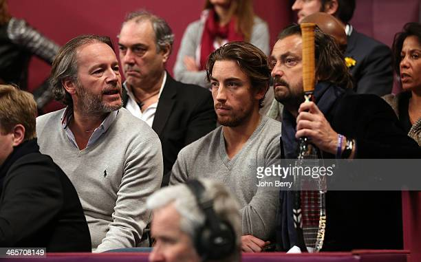 JeanMichel Maire Maxime Leconte and his father Henri Leconte look on during the Amelie Mauresmo Tennis Night to benefit the 'Institut Curie' to fight...