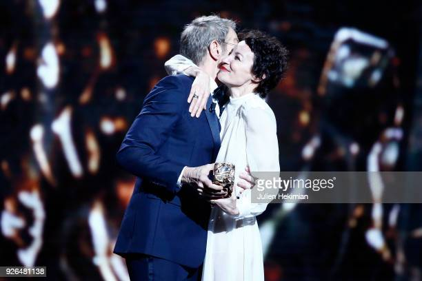 Jeanne Balibar receives from Lambert Wilson the Best Actress Award for the movie 'Barbara' during the Cesar Film Awards 2018 at Salle Pleyel on March...