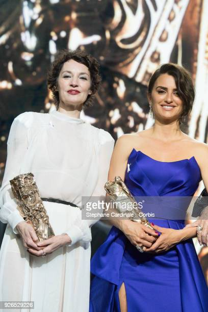 Jeanne Balibar receives the Best Actress Award for the movie 'Barbara' with Penelope Cruz with the honourary Cesar Award during the ceremony of the...