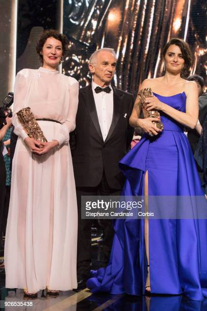 Jeanne Balibar receives the Best Actress Award for the movie 'Barbara' Alain Terzian and Penelope Cruz with the honourary Cesar Award during the...