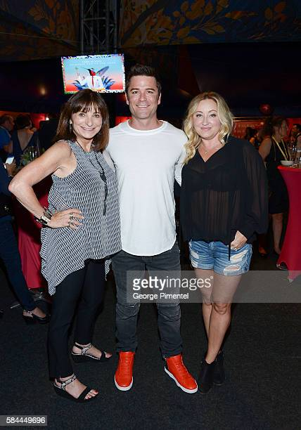 Jeanne Beker Yannick Bisson and Shantelle Bisson attend the opening of Cirque Du Soleil's Luzia at Port Lands on July 28 2016 in Toronto Canada