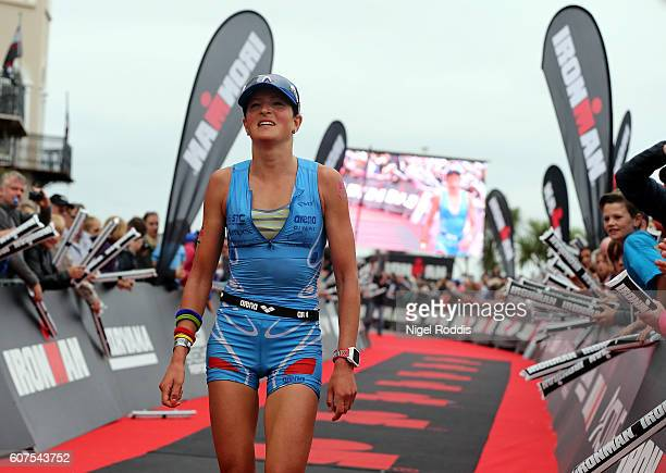 Jeanne Collonge of France reacts after finishing second in the Women's race at Ironman Wales on September 18 2016 in Pembroke Wales
