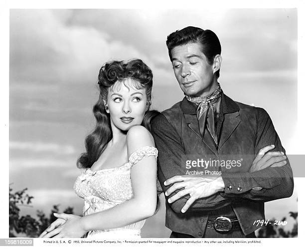 Jeanne Crain and George Nader flirting with one an other in a scene from the film 'The Second Greatest Sex' 1955