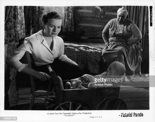 Jeanne Crain looking away from Ethel Waters in a scene from the film 'Pinky', 1949.