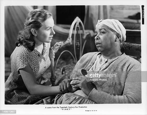 Jeanne Crain offers her hand to Ethel Waters in a scene from the film 'Pinky' 1949