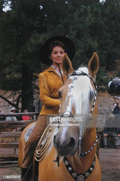 Jeanne Crain rides a horse in circa 1959.