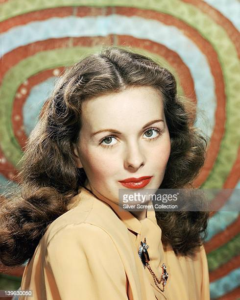 Jeanne Crain US actress wearing a pale orange blouse in a studio portrait circa 1950
