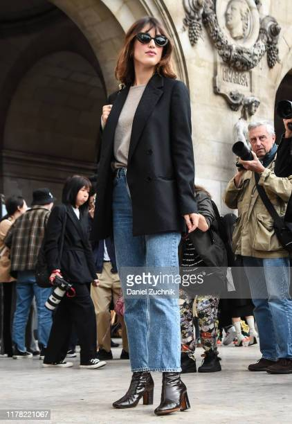 Jeanne Damas is seen wearing a black Balenciaga jacket blue jeans black leather bag and brown leather boots outside the Stella McCartney show during...