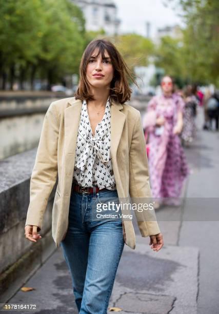 Jeanne Damas seen wearing denim jeans, beige blazer outside Valentino during Paris Fashion Week Womenswear Spring Summer 2020 on September 29, 2019...
