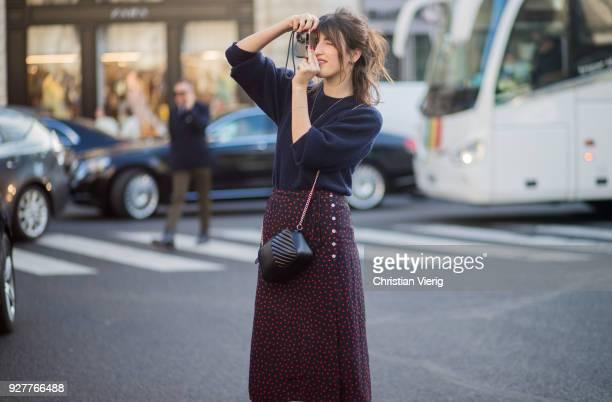 Jeanne Damas taking a photo is seen outside Stella McCartney during Paris Fashion Week Womenswear Fall/Winter 2018/2019 on March 5 2018 in Paris...