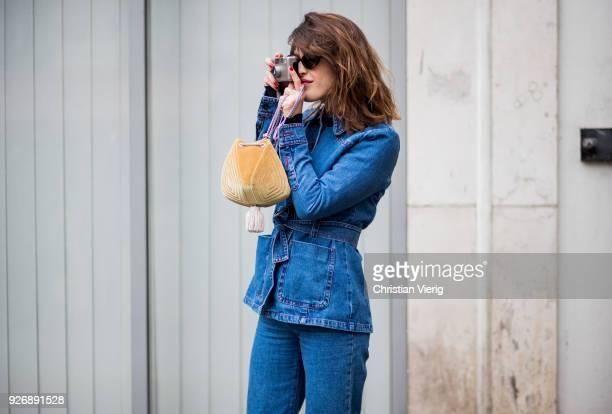 Jeanne Damas taking a photo with her camera is seen outside Altuzarra during Paris Fashion Week Womenswear Fall/Winter 2018/2019 on March 3 2018 in...