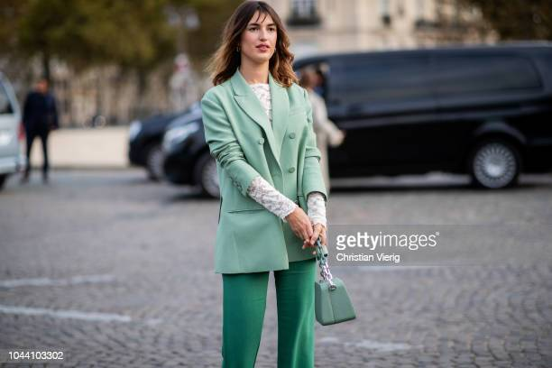 Jeanne Damas wearing green blazer flared pants is seen outside Valentino during Paris Fashion Week Womenswear Spring/Summer 2019 on September 30 2018...