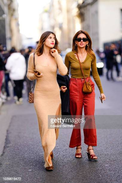 Jeanne Damas wears a beige wool dress outside Jacquemus during Paris Fashion Week Womenswear Spring/Summer 2019 on September 24 2018 in Paris France