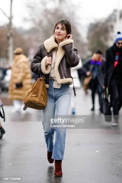 Jeanne Damas wears an aviator brown coat a brown Jacquemus bag outside Jacquemus during Paris Fashion Week Menswear F/W 20192020 on January 20 2019...