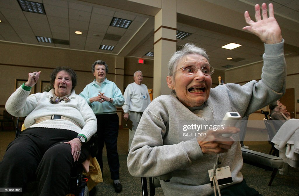 Jeanne Gildea (R), 81, reacts to a shot as she plays in a bowling tournament against fellow community members, including Elaine Fowler (L), 82, on the Nintendo Wii game system at the Riderwood Retirement Community in Silver Spring, Maryland, 16 January 2008. Seniors in a retirement complex in the Washington suburbs have hopped onto the videogame craze, belatedly but with a vengeance, swinging their arms in a virtual game of bowling. AFP PHOTO/Saul LOEB