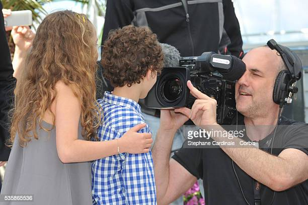 Jeanne Jestin and Elyes Aguis attend Le Passe photo call during the 66th Cannes International Film Festival.