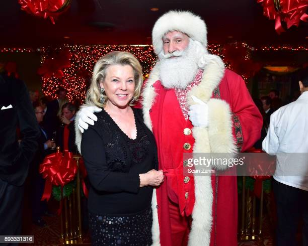 Jeanne Lawrence and Santa Claus attend A Christmas Cheer Holiday Party 2017 Hosted by George Farias and Anne and Jay McInerney at The Doubles Club on...