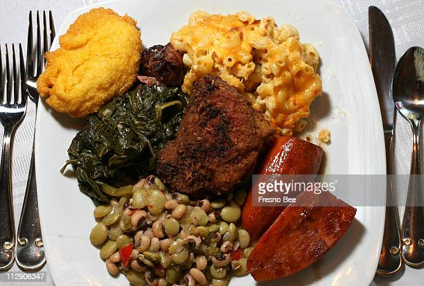 Jeanne Logan prepared this traditional Sunday dinner at her Fresno home including southern fried chicken at center surrounded by clockwise from upper...