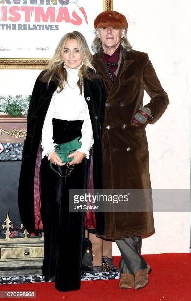 Jeanne Marine and Sir Bob Geldof attend the Surviving Christmas With The Relatives world premiere at the Vue West End on November 21 2018 in London...