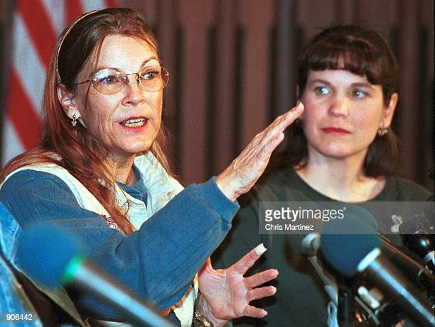 Jeanne Moore the sole American hostage aboard an Indian Airlines flight gestures while answering reporters questions as her daughter Michelle...
