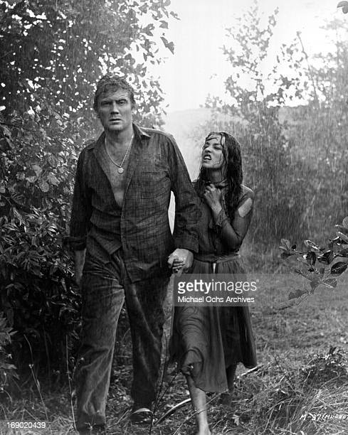 Jeanne Moreau and Ettore Manni walking in the pouring rain in a scene from the film 'Mademoiselle', 1966.