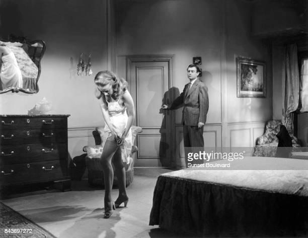 Jeanne Moreau and François Perier on the set of Les Louves directed by Luis Saslavsky