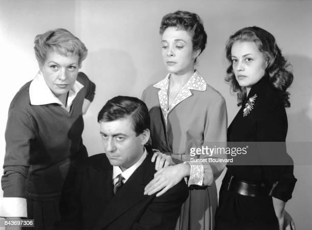 Jeanne Moreau, François Perier, Micheline Presle, Madeleine Robinson on the set of Les Louves directed by Luis Saslavsky.