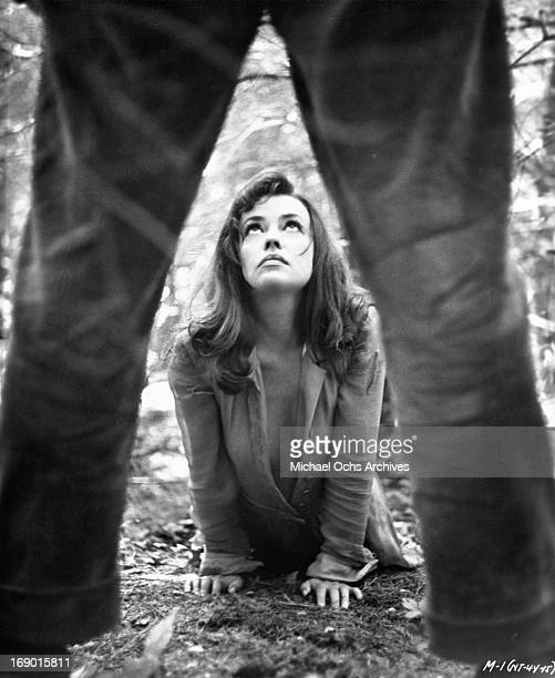 Jeanne Moreau on the ground looking up submissively in a scene from the film 'Mademoiselle' 1966