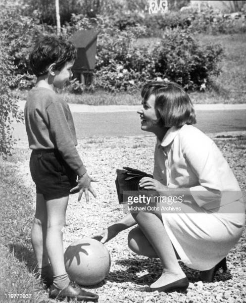 Jeanne Moreau plays with victim Morane's son Chrisophe Brunot in a scene from the film 'The Bride Wore Black', 1968.
