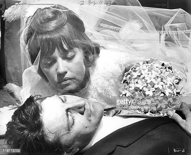Jeanne Moreau stoops to kiss her murdered bridegroom Serge Rousseau in a scene from the film 'The Bride Wore Black' 1968