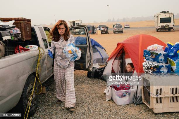 Jeanne Neeley of Berry Creek and her ten-year old daughter, Faith Neeley get settled in their shelters at the Red Cross Evacuation center at the...
