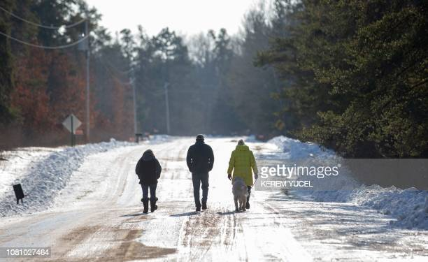 Jeanne Nutter departs after speaking to the press on January 11 2019 in Gordon Wisconsin Nutter walking her dog near the cabin she owns with her...