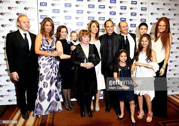 Jeanne Pratt and her family pose for a family photo as they greet guests at the American Australian Association Benefit Dinner at Crown Palladium on...