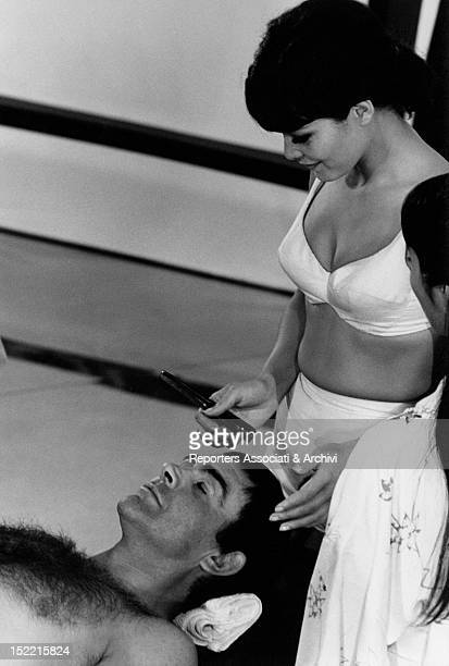 Jeanne Roland who plays a masseuse takes care of Sean Connery who plays James Bond in a scene from You only live twice it's the fifth episode of...