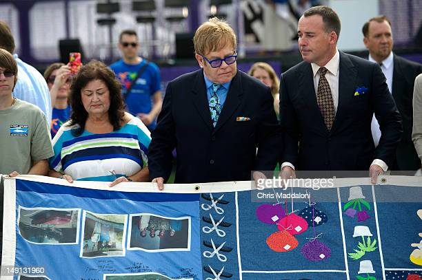 Jeanne White singer Elton John and his partner David Furnish visits the AIDS Memorial Quilt on the Mall The 2012 International AIDS Conference in...