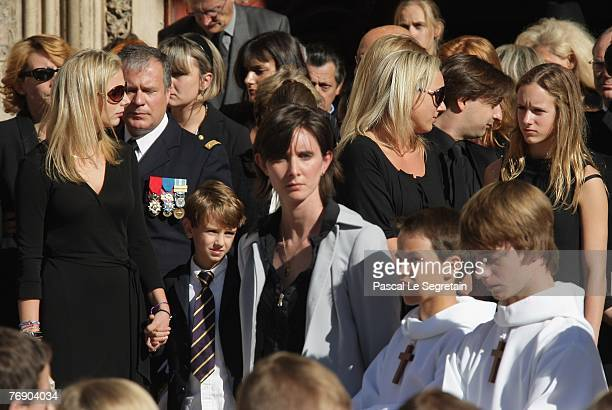 JeanneMarie Martin Clovis Martin Judith Martin and Juliette Martin leave the Cathedral St Jean after the French TV star Jacques Martin's funeral on...
