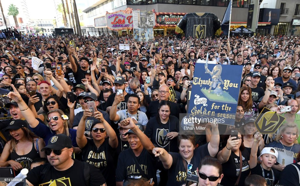 Jeannette Hall of Nevada holds up a sign thanking the Vegas Golden Knights as fans cheer during the team's 'Stick Salute to Vegas and Our Fans' event at the Fremont Street Experience on June 13, 2018 in Las Vegas. Nevada. The Golden Knights made it to the Stanley Cup Final in the team's inaugural season, losing to the Washington Capitals four games to one in the series.
