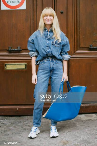 Jeannette Madsen poses with a Jil Sander bag after the Thom Browne show at the Ecole des Beaux Arts during Paris Fashion Week Womenswear Spring...