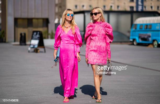 Jeannette Madsen Thora Valdimars wearing pink dress is seen outside Munthe during the Copenhagen Fashion Week Spring/Summer 2019 on August 9 2018 in...