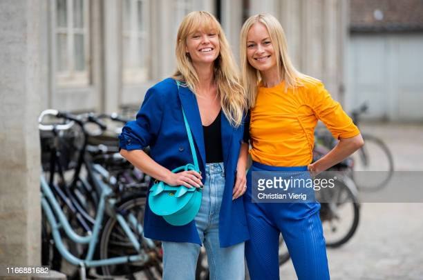 Jeannette Madsen wearing blue blazer denim jeans and Thora Valdimars seen wearing orange longshirt and blue bag outside Designers Remix during...