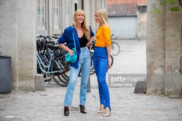 Jeannette Madsen wearing blue blazer, denim jeans and Thora Valdimars seen wearing orange longshirt and blue bag outside Designers Remix during...