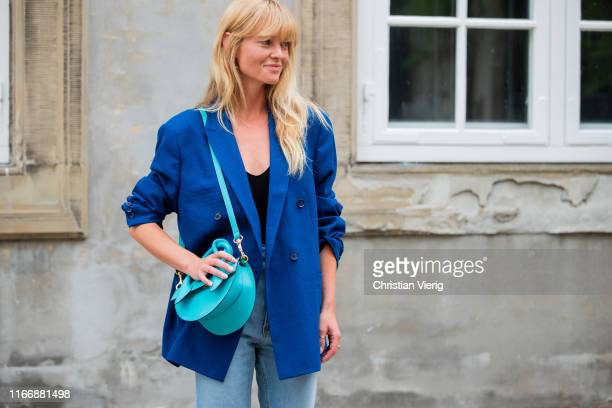 Jeannette Madsen wearing blue blazer, denim jeans outside Designers Remix during Copenhagen Fashion Week Spring/Summer 2020 on August 08, 2019 in...