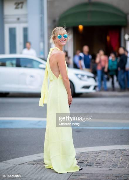 Jeannette Madsen wearing yellow jumpsuit seen outside Baum und Pferdgarten during the Copenhagen Fashion Week Spring/Summer 2019 on August 9, 2018 in...