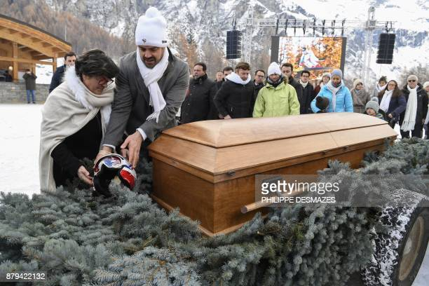 Jeannette Poisson mother of late French skier David Poisson places his helmet near his coffin during a ceremony in his memory in PeiseyNancroix in...