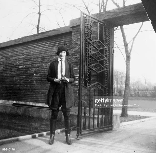 Jeannette Wilber in front of garage courtyard gates Chicago Illinois ca 1924